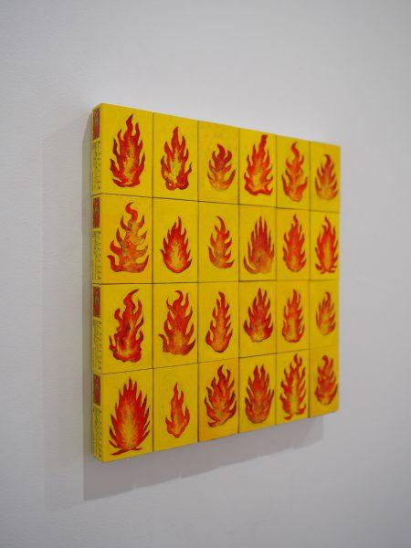 「火(1〜24)」マッチ箱に描かれています
